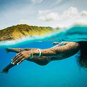 Female floating in clear blue water on the West Side of O'ahu, Hawaii. water, Trevor Clark Photography, Clarkbourne Creative, Laurel Winterbourne, www.clarkbourne.com