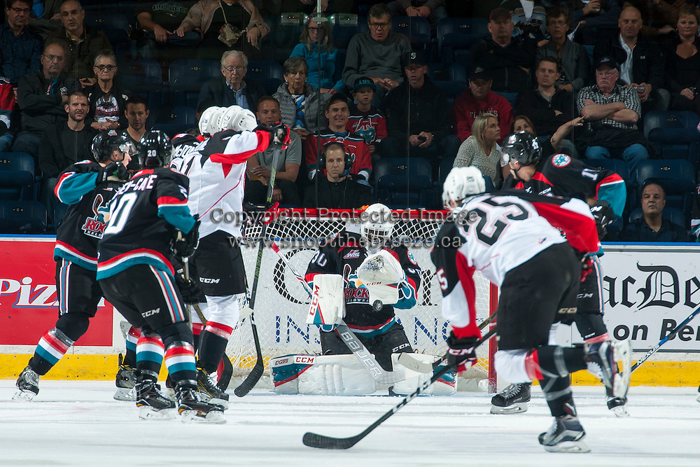 KELOWNA, CANADA - SEPTEMBER 28: Michael Herringer #30 of Kelowna Rockets makes a save on a shot by Tate Olson #25 of Prince George Cougars on September 28, 2016 at Prospera Place in Kelowna, British Columbia, Canada.  (Photo by Marissa Baecker/Shoot the Breeze)  *** Local Caption *** Tate Olson; Michael Herringer;