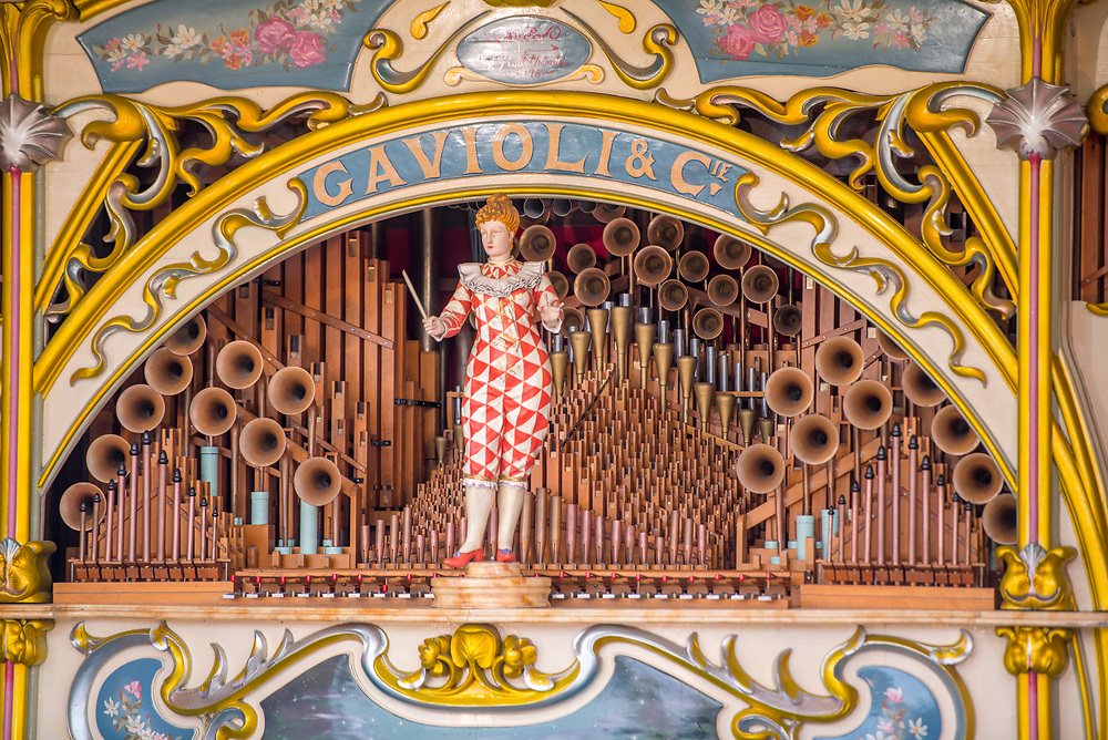 Close up of female conductor figure adorning fairground organ, Masham, North Yorkshire, UK
