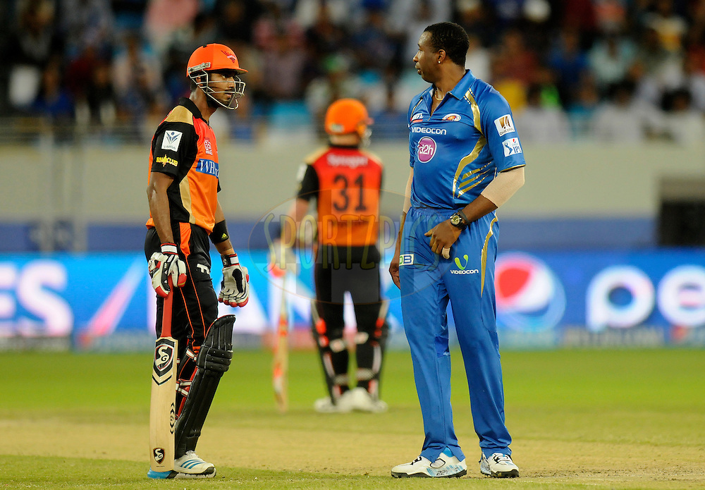 Kieron Pollard of the Mumbai Indians exchanges few words with K.L Rahul of the Sunrisers Hyderabad during match 20 of the Pepsi Indian Premier League Season 2014 between the Mumbai Indians and the Sunrisers Hyderabad held at the Dubai International Stadium, Dubai, United Arab Emirates on the 30th April 2014<br /> <br /> Photo by Pal Pillia / IPL / SPORTZPICS