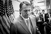 Speaker of the House JOHN BOEHNER (R-OH) leaves a press conference on Capitol Hill Wednesday after Republican leaders stepped up calls for at least a one-year extension of the George W. Bush-era tax rates.