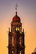 Colorful sunset over the neoclassical bell tower of the San Francisco church in the historic city center of San Miguel de Allende, Mexico.