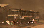 August 16, 2016 - A bus and structures burn off of Highway 138 as the Blue Cut Fire rages through San Bernardino County Tuesday August 16, 2016. The fire has scorched at least 18,000 acres and forced 82,000 people to evacuate their homes in San Bernardino County. <br /> ©Exclusivepix Media