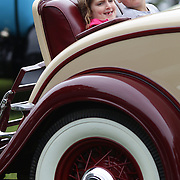 Two children sit in a 1932 Packard Light Eight at the Greenwich Concours d'Elegance Festival of Speed and Style featuring great classic vintage cars. Roger Sherman Baldwin Park, Greenwich, Connecticut, USA.  2nd June 2012. Photo Tim Clayton