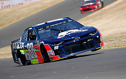June 22, 2018 - Sonoma, CA, U.S. - SONOMA, CA - JUNE 22: Alex Bowman, driver of the Hendrick Motorsports Axalta Chevrolet gets one wheel in the air as he goes through the esses during practice for the Monster Energy NASCAR Cup Series - Toyota/Save Mart 350 at Sonoma Raceway in Sonoma, CA. (Photo by Larry Placido/Icon Sportswire) (Credit Image: © Larry Placido/Icon SMI via ZUMA Press)