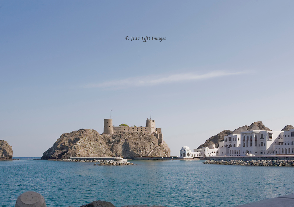 Muscat, harbor behind Sultan's Palace, view across to Jelali fort, built by the Portuguese in the 16th century and still used by the Omani military.