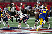 New England Patriots center David Andrews (60), Patriots offensive guard Joe Thuney (62), and Patriots offensive tackle Trent Brown (77), pass block as Los Angeles Rams linebacker Dante Fowler Jr. (56) and Rams defensive end Michael Brockers (90) rush during the NFL Super Bowl 53 football game on Sunday, Feb. 3, 2019, in Atlanta. The Patriots defeated the Rams 13-3. (©Paul Anthony Spinelli)