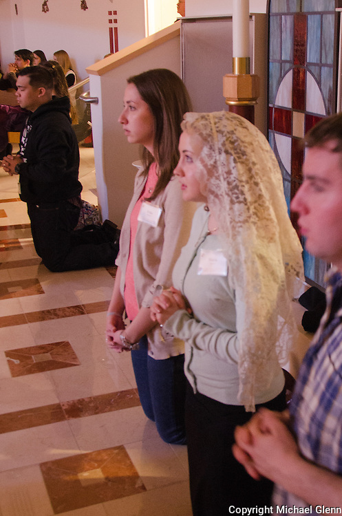 Jan. 25, 2014 Piscataway USA // Maria Byrne wears a veil while attending afternoon prayer at the New Jersey Catholic Young Adult Conference
