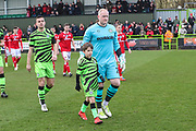 Forest Green Rovers goalkeeper Conrad Logan(26), on loan from Mansfield Town with mascot during the EFL Sky Bet League 2 match between Forest Green Rovers and Walsall at the New Lawn, Forest Green, United Kingdom on 8 February 2020.