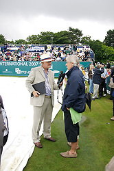 Liverpool, England - Wednesday, June 13, 2007: Bjorn Borg on a rainy and wet centre court at Calderstones as he is interviewed by Radio Merseyside's Alan Jackson during action on day two of the Liverpool International Tennis Tournament. Bjorn was scheduled to play his first match on grass since 1981 but was forced to withdraw after a dog bit his leg. For more information visit www.liverpooltennis.co.uk. (Pic by David Rawcliffe/Propaganda)