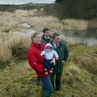 Steve Sankey, Chief Exec of SWT with the trust's 20,000th member Andrew and Lucy Aitchison with son Tom....They are pictured at Cullaloe Wildlife Reserve in Fife...<br />