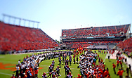Sep 24, 2016; Blacksburg, VA, USA; (Editors note: tilt-shift lens used with this image) The Virginia Tech Hokies run onto the field before the game against the East Carolina Pirates at Lane Stadium. Mandatory Credit: Peter Casey-USA TODAY Sports
