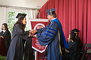 University of Chicago Convocation<br /> <br /> Renee Granville-Grossman (RGG) West Ceremony<br /> <br /> Professor Philippe Guyot-Sionnest, right, hands out diplomas as his wife Caryl Gout reads names.