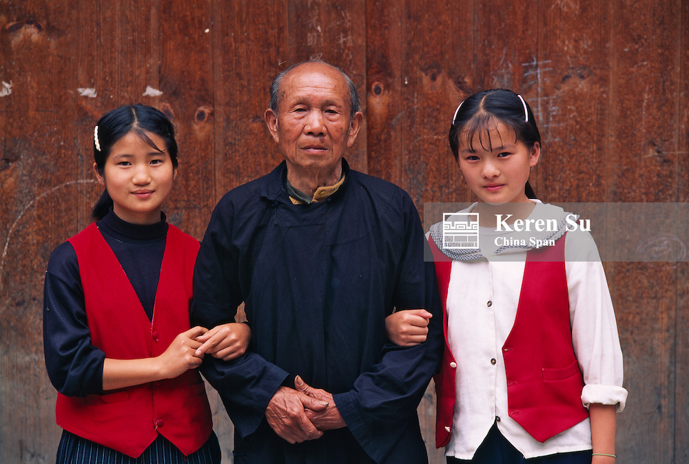 Old man with granddaughters, China