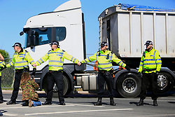 UK ENGLAND BLACKPOOL 3MAY17 - A police cordon shields arriving vehicles from protesters at the entrance to Cuadrilla's Preston New Road fracking site near Blackpool  in Lancashire, northern England.<br /> <br /> The campaigners  intend to stop preparation works for the first UK frack site for gas, after the government overruled the local council decision to reject planning permission.<br /> <br /> <br /> <br /> jre/Photo by Jiri Rezac / Greenpeace<br /> <br /> <br /> <br /> © Jiri Rezac 2017