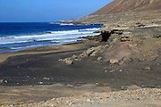 Waves black sand beach Playa la Solapa,  near Paraja, Fuerteventura, Canary Islands, Spain