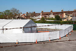 © Licensed to London News Pictures; 13/04/2020; Bristol, UK. A temporary morgue has been built at the Bristol City Council Sandy Park depot in Brislington in case it is needed for victims of coronavirus. The morgue facility will be able to take up to 240 bodies in six chilled containers covered by marquees. This will increase local morgue capacity by two thirds and this temporary morgue will be only for victims of Covid-19 Photo credit: Simon Chapman/LNP.