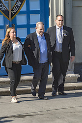 Harvey Weinstein smiling leaving the police precint in handcuffs. 25 May 2018 Pictured: Harvey Weinstein smiling leaving the police precint in handcuffs. Photo credit: Sahara / MEGA TheMegaAgency.com +1 888 505 6342