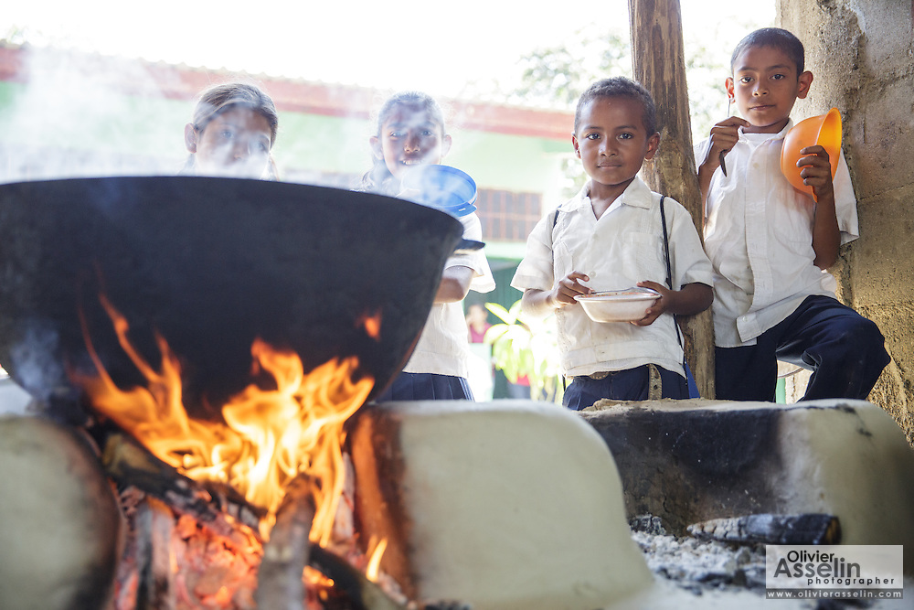 Children wait to get served lunch at the primary school in the town of Coyolito, Honduras on Wednesday April 24, 2013.