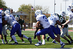 17 September 2011: Steve Rivera looks for a running lane during an NCAA Division 3 football game between the Aurora Spartans and the Illinois Wesleyan Titans on Wilder Field inside Tucci Stadium in.Bloomington Illinois.
