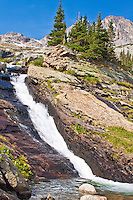 Ribbon Falls below 13,327 ft. Mchenrys Peak in Glacier Gorge.  Rocky Mountain National Park, Colorado.