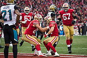 San Francisco 49ers tight end George Kittle (85), left, and San Francisco 49ers wide receiver Trent Taylor (81) celebrate a touchdown against the Jacksonville Jaguars at Levi's Stadium in Santa Clara, Calif., on December 24, 2017. (Stan Olszewski/Special to S.F. Examiner)
