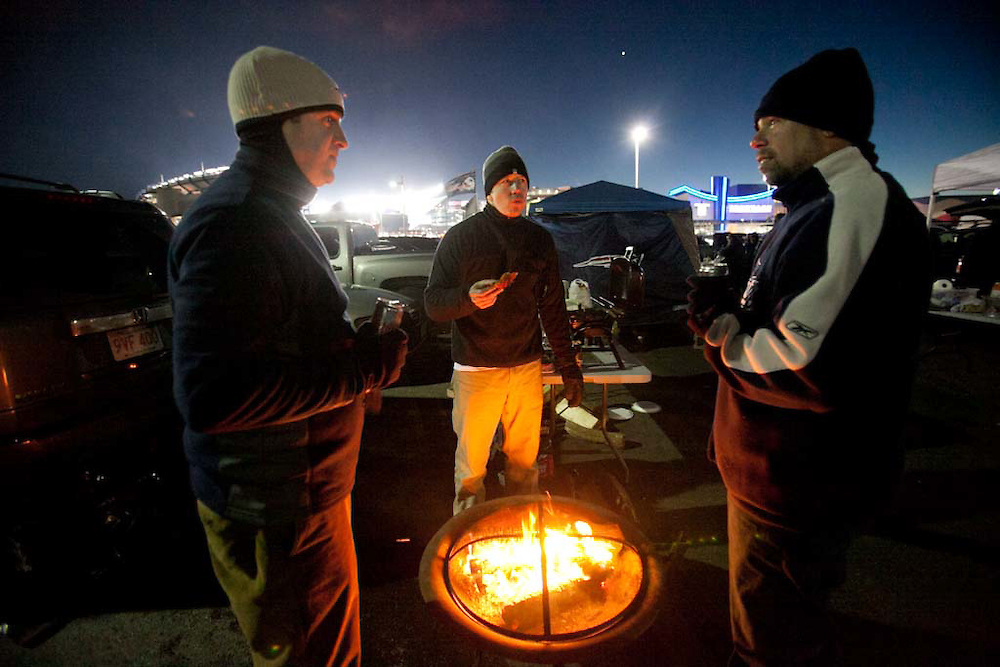 Foxborough, MA 01/14/2012.Patriots fans Jeff, Lay, and Mike, no last names given, stay warm while tailgating before the start of Saturday's AFC Divisional game between the Patriots and the Denver Broncos..Wicked Local Photo by Alex Jones