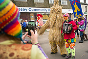 UNITED KINGDOM, Whittlesey: Straw Bear Festival. Morris dancers have their picture taken with 'The Bear', traditionally a mischievous straw character during the Straw Bear festival this weekend. The three day festival, which originated in 1882, consists of traditional Molly, Morris, Clog and Sword dancing as well as parading a large straw character known as 'The Bear' through the town. Rick Findler  / Story Picture Agency