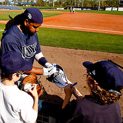 February 25, 2011; Port Charlotte, FL, USA; Tampa Bay Rays left fielder Manny Ramirez (24) signs autographs for fans following a spring training split squad scrimmage at Charlotte Sports Park.  Mandatory Credit: Derick E. Hingle