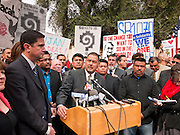 23 JANUARY 2012 - PHOENIX, AZ:     State Senators Dave Lujan and Steve Gallardo (CQ) talk about the damage SB 1070 done to the state at the State Capitol Monday, Jan 23. Both sides of the immigration debate congregated on the capitol grounds to protest against and in favor of SB 1070 and other anti immigration bills. At the same time people were protesting, legislators from both sides of the issue held press conferences.   PHOTO BY JACK KURTZ