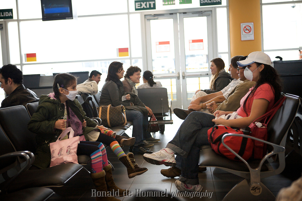 Two girls at the airport Jorge Chavez of Lima are waiting for their flight wearing face masks to protect against the swine flu H1N1.