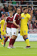 AFC Wimbledon midfielder Chris Whelpdale (11) and Northampton Town midfielder John-Joe O'Toole (21) in action during the EFL Sky Bet League 1 match between Northampton Town and AFC Wimbledon at Sixfields Stadium, Northampton, England on 20 August 2016. Photo by Stuart Butcher.