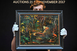 "© Licensed to London News Pictures. 17/11/2017. London, UK.  London, UK.  17 November 2017. A technician presents ""The Goldfish Pool at Chartwell"", circa 1962, by Sir Winston Churchill (Est. GBP 50-80k), the final work Churchill ever painted.  Preview upcoming auctions of Modern & Post War British Art and Scottish Art taking place at Sotheby's, New Bond Street, on 21 and 22 November. Photo credit: Stephen Chung/LNP"