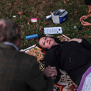 """Social worker Susanne Hooper looks at her husband Adrian after coming down from the high during a """"healing ceremony""""  with """"shaman/sitter"""" Madhu in Lexington on Wednesday, October 18, 2017. Catlett, who wants to start a church using the substance, as well as a growing contingent of users believe the venom can help with reducing and ultimately overcoming many forms of addiction."""