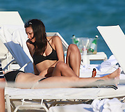 Exclusive <br /> Jamie Foxx's daughter Corinne raises temperatures in mismatched bikini during beach outing in Miami<br /> <br /> Corinne Foxx showed off her star figure while sunbathing in Miami on New Year's Day.<br /> The stunning 22-year-old daughter of Jamie Foxx looked like a perfect 10 lounging beachside Sunday.<br /> 2016's Miss Golden Globe displayed her trim physique wearing a sporty yet sexy two-piece while hanging out with a friend.<br /> ©Jorge Rodriguez/Exclusivepix Media