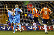 Josh Carson of York City (left) scores the opening goal against Luton Town during the Sky Bet League 2 match at Kenilworth Road, Luton<br /> Picture by David Horn/Focus Images Ltd +44 7545 970036<br /> 10/02/2015