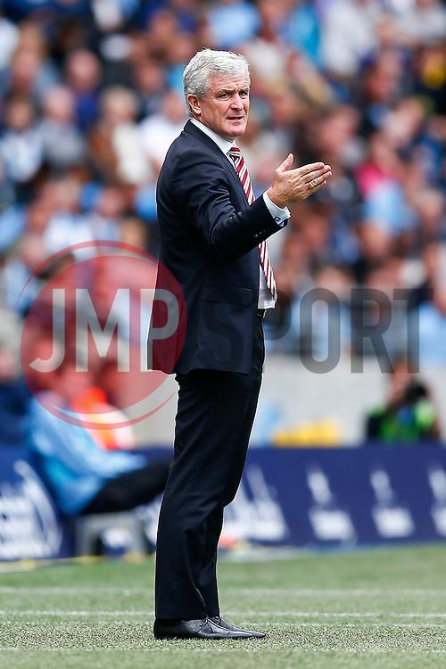 Stoke Manager Mark Hughes gestures - Photo mandatory by-line: Rogan Thomson/JMP - 07966 386802 - 30/08/2014 - SPORT - FOOTBALL - Manchester, England - Etihad Stadium - Manchester City v Stoke City - Barclays Premier League.