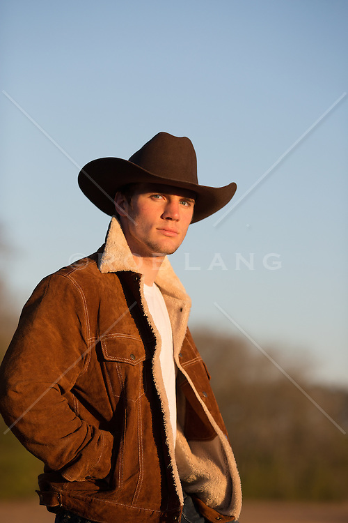 portrait of an All American cowboy in a Marlboro Jacket at sunset
