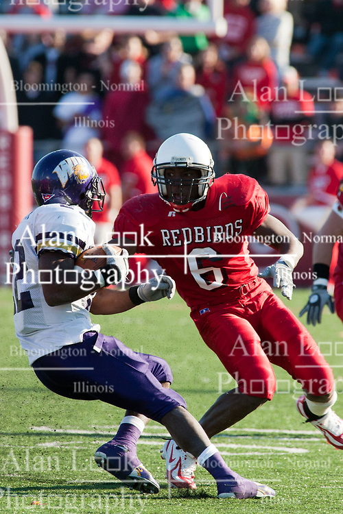 29 October 2005: Redbird Kye Stewart presses on the breaks to change directions with an escaping Leatherneck, Travis Glasford.  With a final score of 31 - 17, Western Illinois University Leathernecks collared the Illinois State University Redbirds knocking them from their 18th ranked perch at Hancock Field on Illinois State's campus in Normal IL