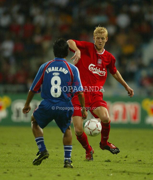 BANGKOK, THAILAND - Thailand. Thursday, July 24, 2003: Liverpool's Zac Whitbread makes his debut against Thailand's Amarin Madlam during a preseason friendly match at the Rajamangala National Stadium. (Pic by David Rawcliffe/Propaganda)