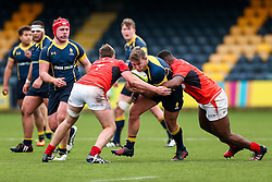 Cameron Harrison (St John's College, Zimbabwe) of Worcester Warriors U18 is tackled by Sean Reffell (capt) of Saracens U18 - Rogan Thomson/JMP - 16/02/2017 - RUGBY UNION - Sixways Stadium - Worcester, England - Worcester Warriors U18 v Saracens U18 - Premiership Rugby Under 18 Academy Finals Day 5th Place Play-Off.
