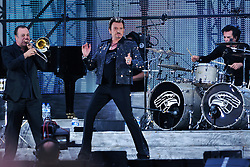 File photo : Johnny Hallyday performs during a free concert at the 'Champs de Mars' in front of the Eiffel Tower in Paris, France on July 14, 2009, for the celebration of the 120 years old of the Eiffel Tower and the Bastille Day. Photo Nicolas Genin/ABACAPRESS.COM