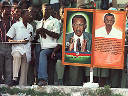 Supporters of Aristide. US and UN troops arrive in Haiti as the first election since the coup and embargo that displaced Jean Bertrand Aristide takes place and Rene Preval is elected president. Port au Prince, Haiti, 1996.