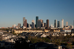 Daytime skyline of Houston, Texas with residential neighborhood in the foreground.