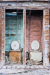 Abandonded bathroom and toilet seats, Bombay  Beach, Salton Sea, California