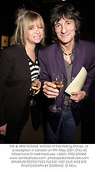 MR & MRS RONNIE WOOD of the Rolling Stones, at a reception in London on 9th May 2001.	ONU 60