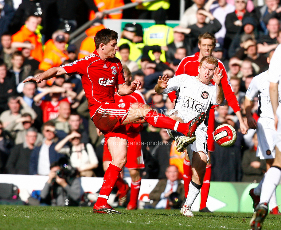 Liverpool, England - Saturday, March 3, 2007:  Liverpool's Xabi Alonso is hammered into by Manchester United's Paul Scholes, who completely misses the ball, yet the referee indicates no foul saying the Manchester United player won the ball during the Premiership match at Anfield. (Pic by David Rawcliffe/Propaganda)