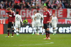 08.02.2014, easyCredit Stadion, Nuernberg, GER, 1. FBL, 1. FC Nuernberg vs FC Bayern Muenchen, 20. Runde, im Bild Frust bei Mike Frantz (1 FC Nuernberg / vorne rechts), Ondrej Petrak (1 FC Nuernberg / hinten links) nach dem Gegentor zum 0:1 Im Hintergrund die jubelnden Bayern // during the German Bundesliga 20th round match between 1. FC Nuernberg and FC Bayern Munich at the easyCredit Stadion in Nuernberg, Germany on 2014/02/08. EXPA Pictures © 2014, PhotoCredit: EXPA/ Eibner-Pressefoto/ MERZ<br /> <br /> *****ATTENTION - OUT of GER*****