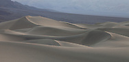 As the sun sets, the soft light give the sand dunes a buttery feel, Death Valley National Park