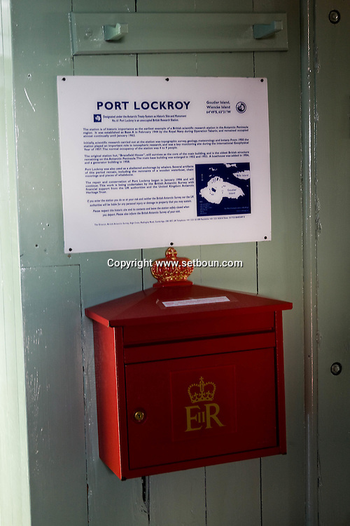 Antactica. port Lockroy british base, souvenir shop, tourists  GOUDIER island - Antarctica  <br /> /<br /> port Lockroy  base anglaise, magasin de souvenirs du bout du monde, touristes<br /> Shopping base anglaise de Port Lockroy sur l'île de Goudier<br /> Ecussons, 10 $<br /> Mini-map, 5 $<br /> Visitor's kit (posters sur la vie sauvage en Antarctique), 5 $<br /> First day cover stamp, 8-10 $<br /> Cartes postales, 1 ou 2 $<br /> Stylos, 1 $<br /> Magnets, 8 $<br /> Carvate en tartan, 25 $<br /> Carré en soie tartan, 45 $<br /> Bonnets, 20 $<br /> Tee-shirt, 30 $<br /> Polos, 50 $<br /> Peluches manchots, 15 $<br /> Stickers, 1 $<br /> Tea towel, 15 $  ile GOUDIER - Antarctique <br /> /<br /> ANTAR056